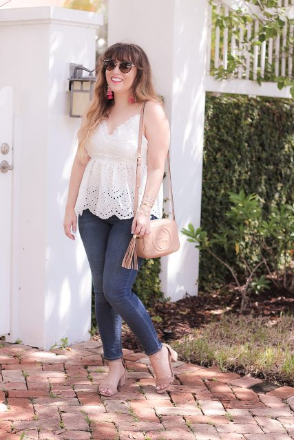 With beige tassel bag, skinny jeans and beige low heeled sandals