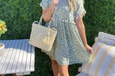 With beige tote bag and beige ankle strap sandals