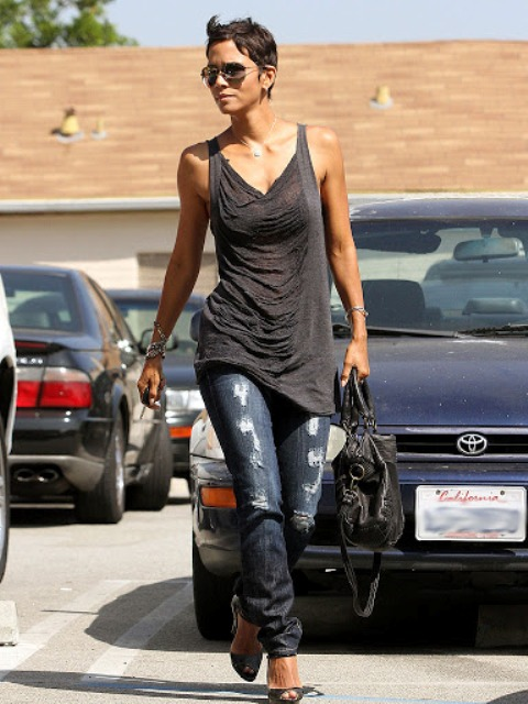 With black bag, distressed jeans and black shoes