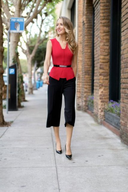With black culottes and black pumps