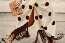 With black lace up top, straw clutch and black heeled mules