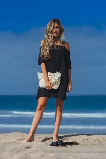 With black off the shoulder mini dress and black sandals