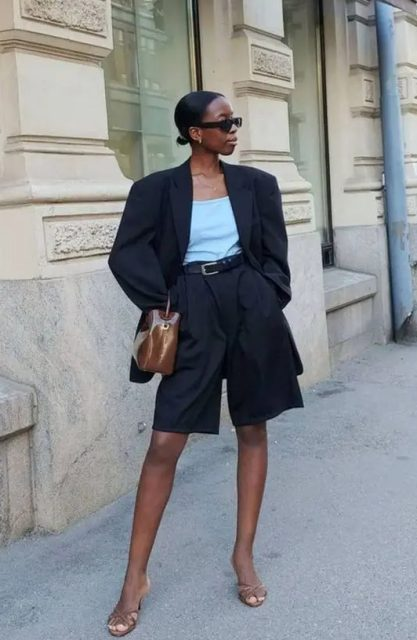 With black oversized blazer, high heels and brown patent leather bag
