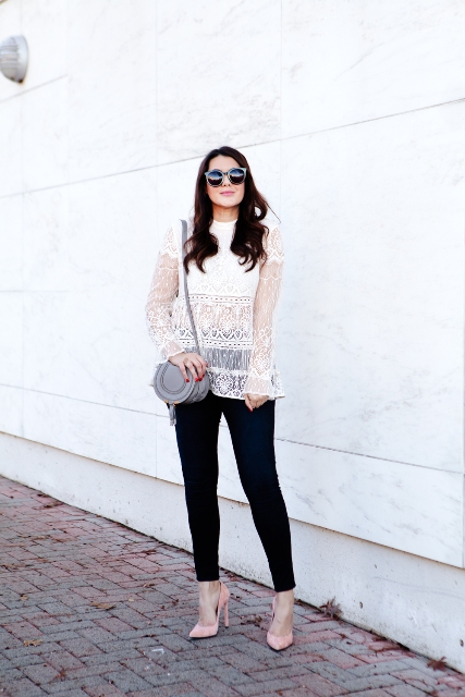 With black pants, gray leather bag and pale pink pumps