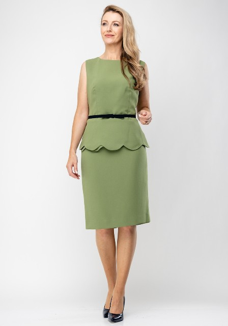 With black patent leather pumps and green knee-length skirt