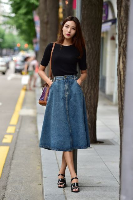 With black shirt, brown leather bag and black patent leather sandals
