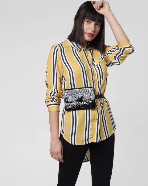 With black skinny pants and black leather waist bag