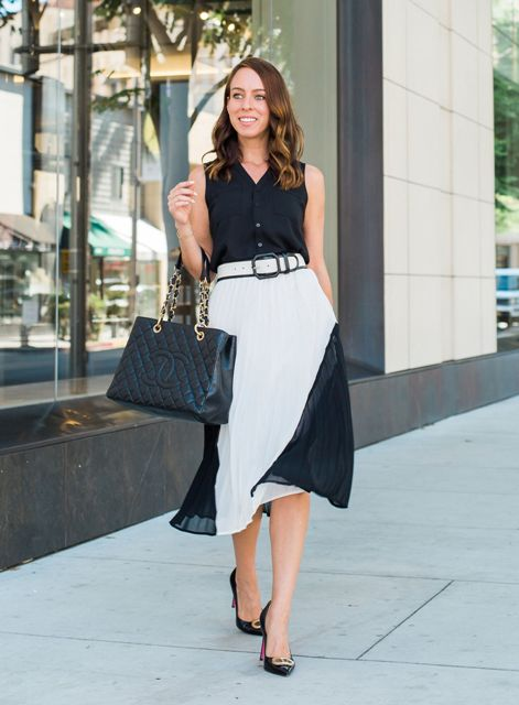 With black sleeveless top, black chain strap bag and black embellished pumps