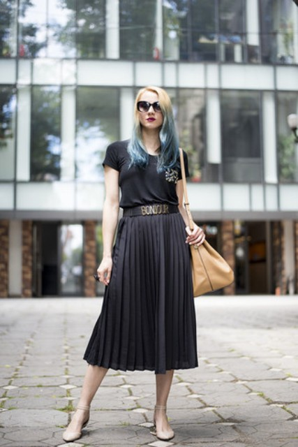 With black t-shirt, beige leather tote bag and beige ankle strap flat shoes