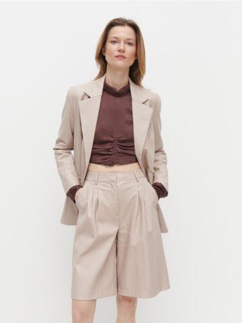 With brown crop shirt and beige loose blazer