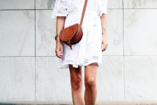 With brown leather crossbody bag and brown lace up sandals