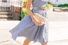 With checked sleeveless belted knee-length dress and brown leather sandals