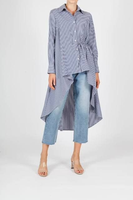 With cropped jeans and transparent mules