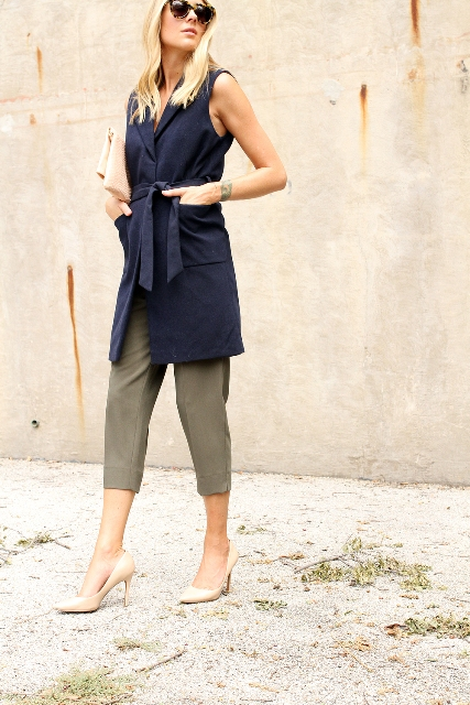With cropped pants and beige pumps