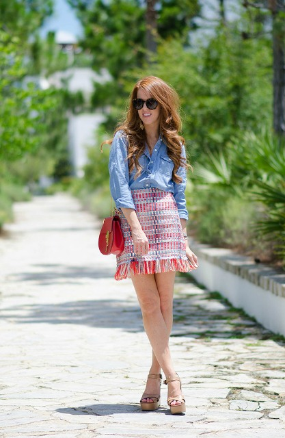 With denim button down shirt, red chain strap bag and platform sandals
