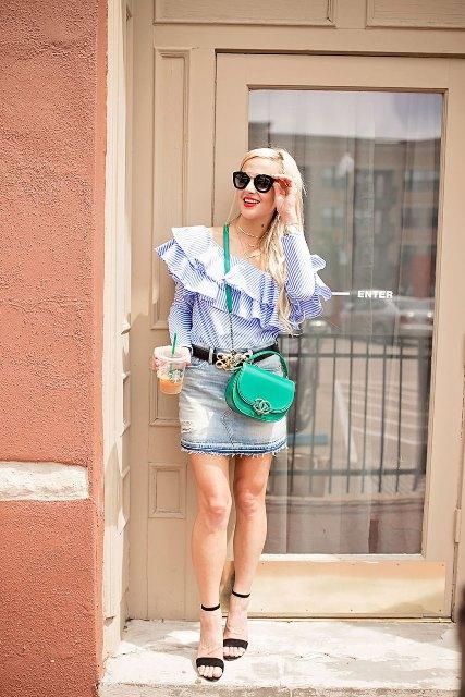 With denim mini skirt, green crossbody bag and black ankle strap high heels