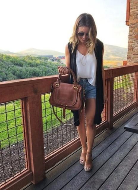With denim shorts, black long vest, bag and sandals