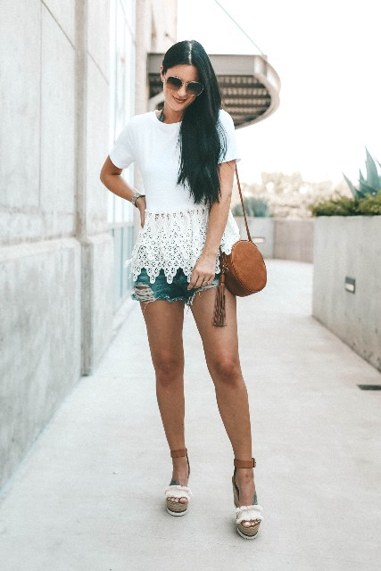 With distressed denim shorts, brown rounded bag and platform sandals