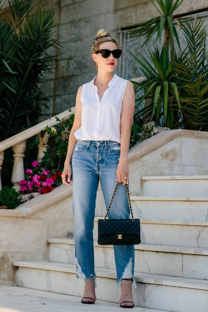 With distressed jeans, black chain strap bag and black high heels