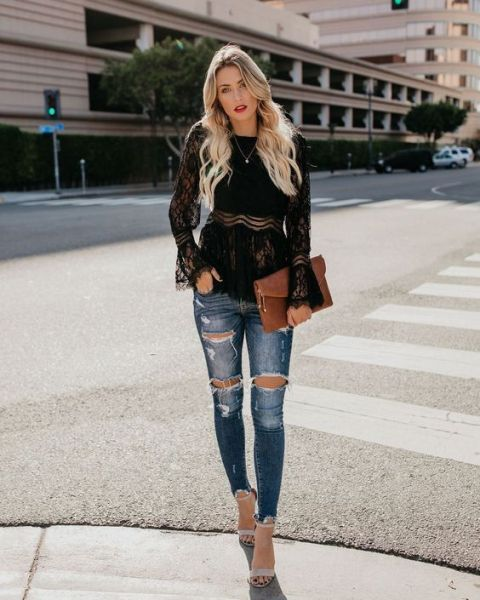 With distressed skinny jeans, beige ankle strap high heels and brown clutch