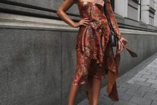 With floral one shoulder dress and black mini bag