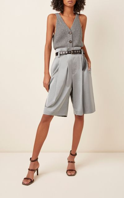 With gray button down sleeveless top and brown lace up sandals