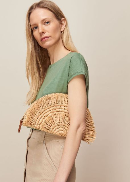 With green t-shirt and beige button front skirt