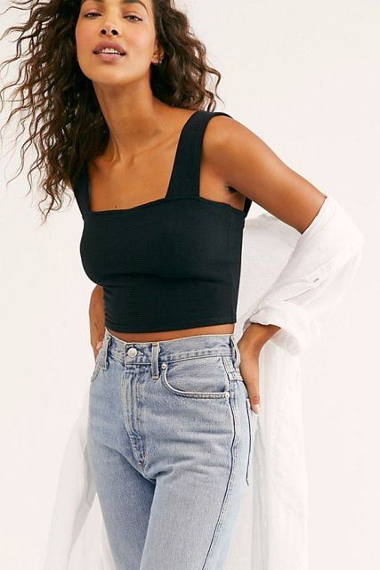 With high waisted jeans and white shirt