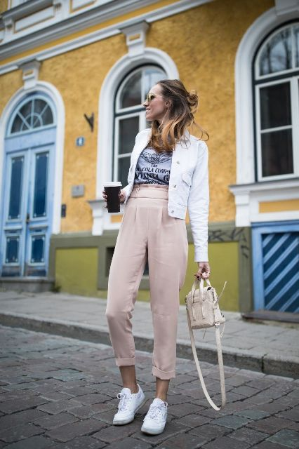 With labeled t-shirt, white jacket, beige bag and white sneakers