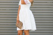 With leopard printed clutch and beige high heels
