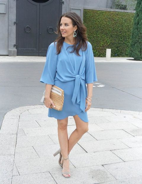 With light blue belted wrap dress and gray suede ankle strap high heels