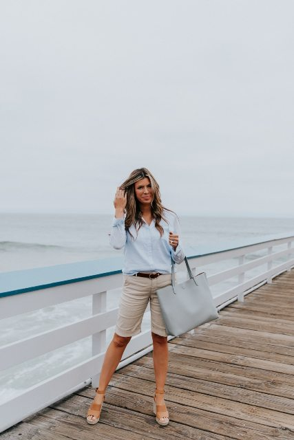 With light blue button down shirt, gray tote bag and brown platform sandals