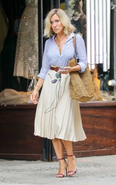 With light blue button down shirt, straw tote bag and ankle strap sandals