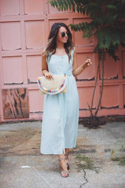 With light blue button front dress and gray sandals