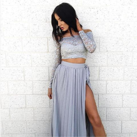 With light blue pleated belted skirt