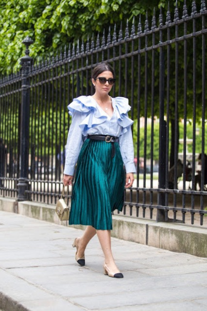 With light blue ruffled blouse and two colored low heeled shoes