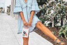 With light blue ruffled mini dress and embellished bag