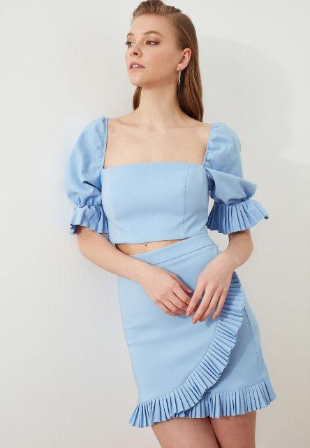 With light blue ruffled mini skirt