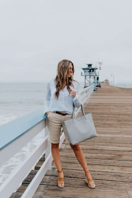 With light blue shirt, light blue leather tote bag and brown ankle strap platform shoes