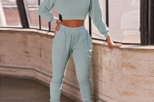 With mint green jogger pants and white sneakers