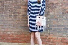 With navy blue and white striped mini dress and white fringe bag