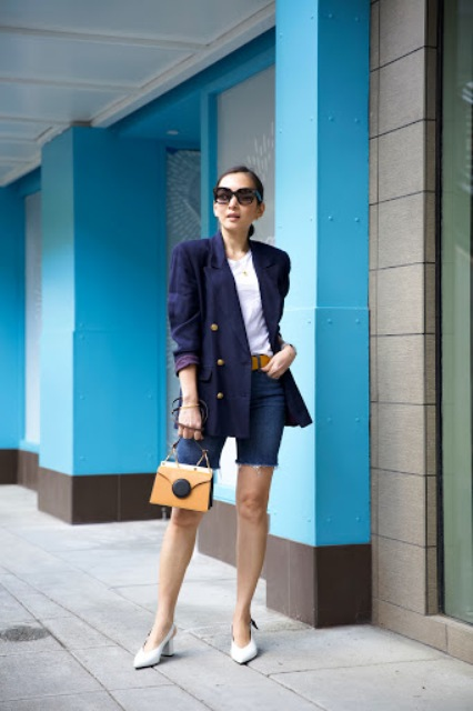 With navy blue blazer, yellow bag, white shoes and white shirt