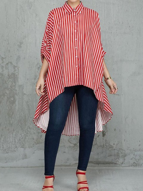 With navy blue skinny jeans and red lace up high heels