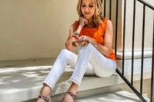 With orange ruffled top and white pants
