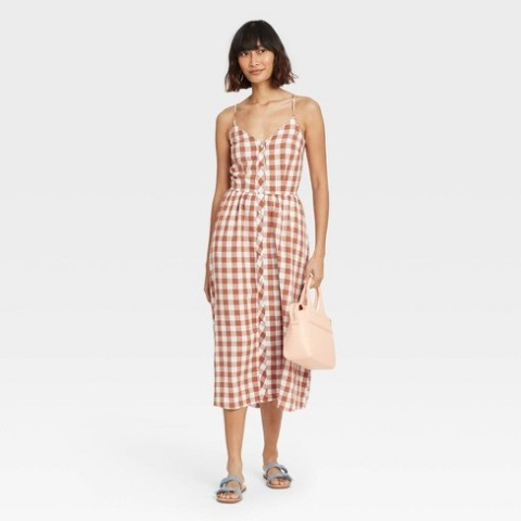 With pale pink bag and flat sandals