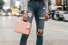 With pale pink box bag, white pumps and distressed jeans