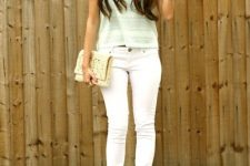 With pastel color t-shirt, white pants and white sandals