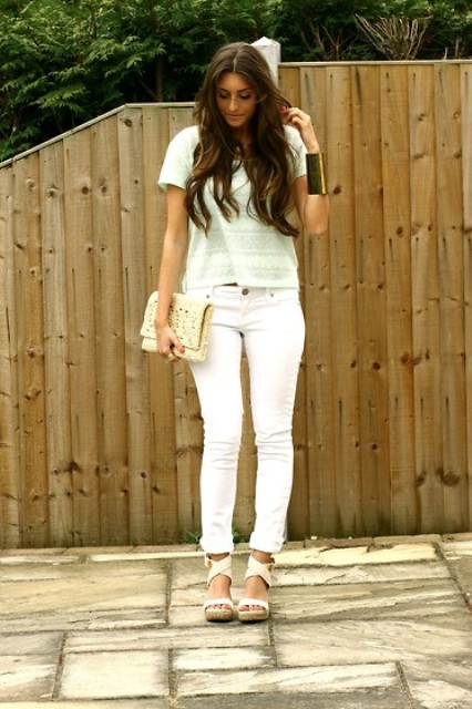 With pastel color t shirt, white pants and white sandals