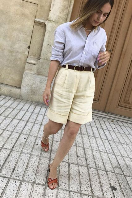 With pastel colored button down shirt and brown low heeled mules