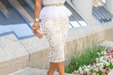 With pastel colored clutch and pale pink pumps
